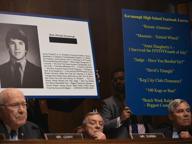 Extracts of his high school yearbook are displayed as Supreme Court nominee Brett Kavanaugh testifies before the US Senate Judiciary Committee in the Dirksen Senate Office Building on Capitol Hill September 27, 2018 in Washington, DC. Kavanaugh was called back to testify about claims by Christine Blasey Ford, who has …