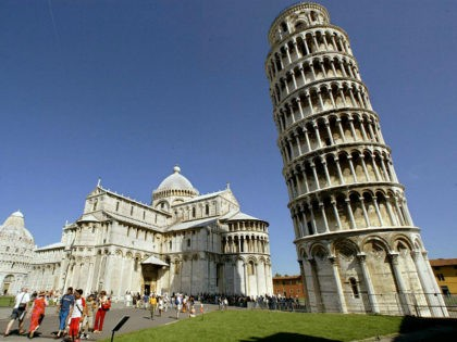 PISA, ITALY - AUGUST 24: Tourists visit the Leaning Tower of Pisa and the Cathedral in the 'Square of Miracle' August 24, 2002 in Pisa, Italy. The tower reopened in December 2001 after 10 years of stabilization work. Visitors can, through the end of August, go to the top of …