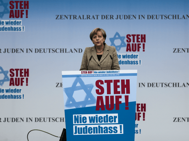 German Chancellor Angela Merkel delivers her speech at a rally against anti-Semitism near the Brandenburg Gate in Berlin, Sunday, Sept. 14, 2014. Thousands of protesters attended the public rally organized by Germany's Jewish community at the capital's Brandenburg Gate after tensions over the Gaza conflict spilled over into demonstrations in …