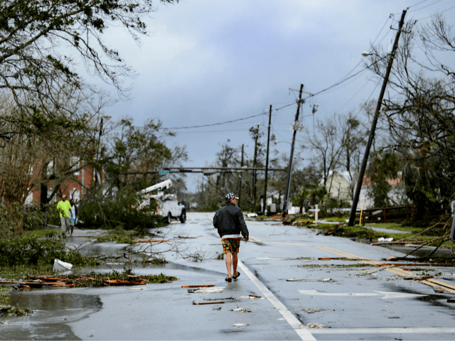 A man walks down the street after Hurricane Michael made landfall on October 10, 2018 in Panama City, Florida. - Michael slammed into the Florida coast on October 10 as the most powerful storm to hit the southern US state in more than a century as officials warned it could …
