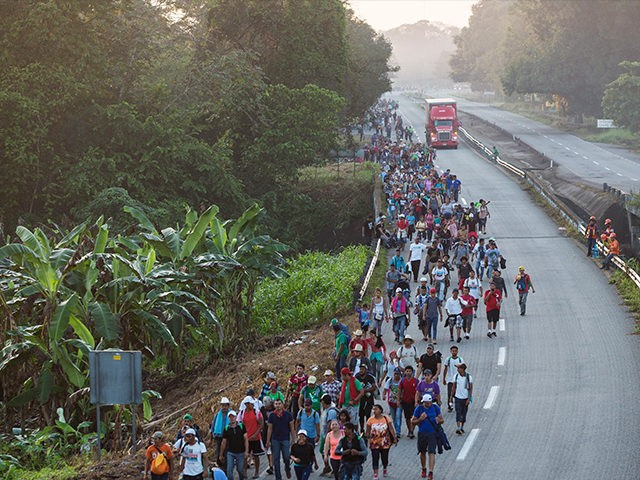 Central American migrants traveling with a caravan to the U.S. make their way to Mapastepec, Mexico, Wednesday, Oct. 24, 2018. Thousands of Central American migrants renewed their hoped-for march to the United States on Wednesday, setting out before dawn with plans to travel another 45 miles (75 kilometers) of the …