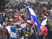 Honduran migrants take part in a caravan towards the United States in Chiquimula, Guatemala on October 17, 2018. - A migrant caravan set out on October 13 from the impoverished, violence-plagued country and was headed north on the long journey through Guatemala and Mexico to the US border. President Donald …