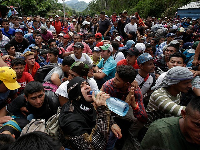 Hundreds of Hondurans are blocked at the border crossing in Agua Caliente, Guatemala, Monday, Oct. 15, 2018. A caravan of Honduran migrant moved towards the country's border with Guatemala in a desperate attempt to flee poverty and seek new lives in the United States. (AP Photo/Moises Castillo)
