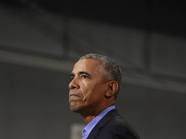 Former President Barack Obama speaks at a rally to support Michigan democratic candidates at Detroit Cass Tech High School on October 26, 2018 in Detroit, Michigan. Obama, and former Attorney General Eric Holder, who was also at the rally, are among approximately a dozen democrats who were targeted by mail …