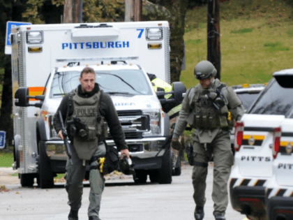 Pittsburgh police officers depart the scene of the mass shooting at the Tree of Life Synagogue in the Squirrel Hill neighborhood of Pittsburgh where 11 people died Saturday. Photo by Archie Carpenter/UPI