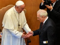 Pope Francis and US director Martin Scorsese (R) shake hands within an intergenerational dialogue themed 'The Wisdom of Time' with some young people and a group of elderly people at the Augustinianum Patristic Institute of higher education in Rome on October 23, 2018. (Photo by Alberto PIZZOLI / AFP) (Photo …