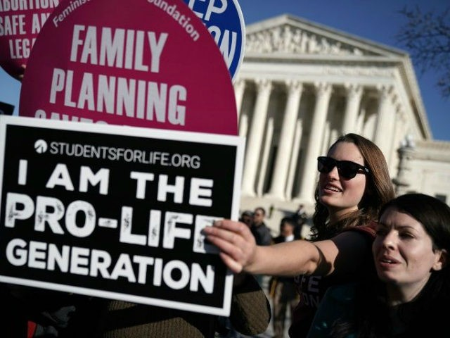 An Iowa bill banning abortions once a fetal heartbeat is detected is expected to trigger a legal battle, which conservatives hope will land the flashpoint social issue back at the US Supreme Court.