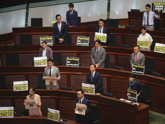 "Pro-democracy lawmakers display placards ""Press freedom persecution"" to protest while Hong Kong Chief Executive Carrie Lam delivering her policy speech at the Legislative Council in Hong Kong Wednesday, Oct. 10, 2018. Hong Kong government has refused to renew the work visa of Victor Mallet, a senior editor of the Financial …"