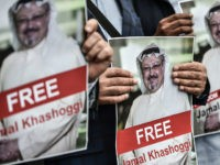 TOPSHOT - Protestors hold pictures of missing journalist Jamal Khashoggi during a demonstration in front of the Saudi Arabian consulate on October 8, 2018 in Istanbul. - Jamal Khashoggi, a veteran Saudi journalist who has been critical towards the Saudi government has gone missing after visiting the kingdom's consulate in …