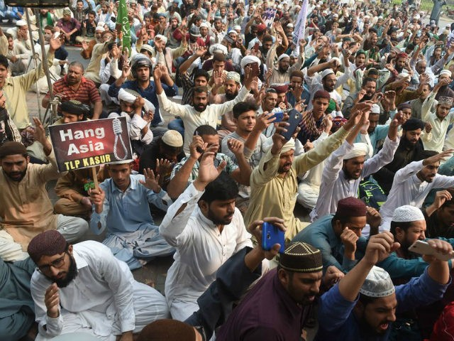Supporters of Tehreek-e-Labaik Pakistan (TLP), a hard-line religious political party, chant slogans during a protest on Wednesday against the court decision to overturn the conviction of Asia Bibi. Arif Ali/AFP/Getty Images