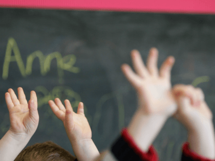 GLASGOW, SCOTLAND - JANUARY 28: Children wave their hands at a private nursery school January 28, 2005 in Glasgow, Scotland. The average price of pre-school care has increased over the past year, sending child care prices to an average of GBP200 in parts of the southeast. Many working parents in …