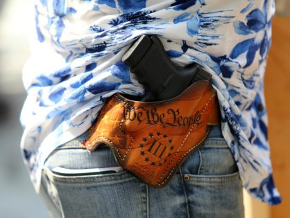 SEATTLE, WA - AUGUST 18: Detail of a holstered firearm of Matt Marshall, leader of the Washington 3%, attend the right-wing 'Liberty or Death - Rally Against Left Wing Violence' outside Seattle City Hall on August 18, 2018 in Seattle, Washington. Right wing groups including Patriot Prayer held a pro-gun …