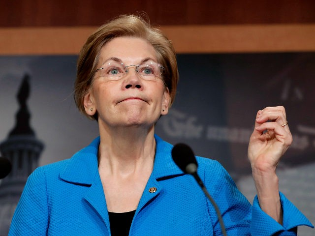 Sen. Elizabeth Warren, D-Mass., a key member of the Banking Committee, expresses her opposition to a move in the Senate to pass legislation that would roll back some of the safeguards Congress put into place after a financial crisis rocked the nation's economy ten years ago, during a news conference …