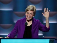 PHILADELPHIA, PA - JULY 25: Sen. Elizabeth Warren (D-MA) stands on stage prior to the start of the first day of the Democratic National Convention at the Wells Fargo Center, July 25, 2016 in Philadelphia, Pennsylvania. An estimated 50,000 people are expected in Philadelphia, including hundreds of protesters and members …