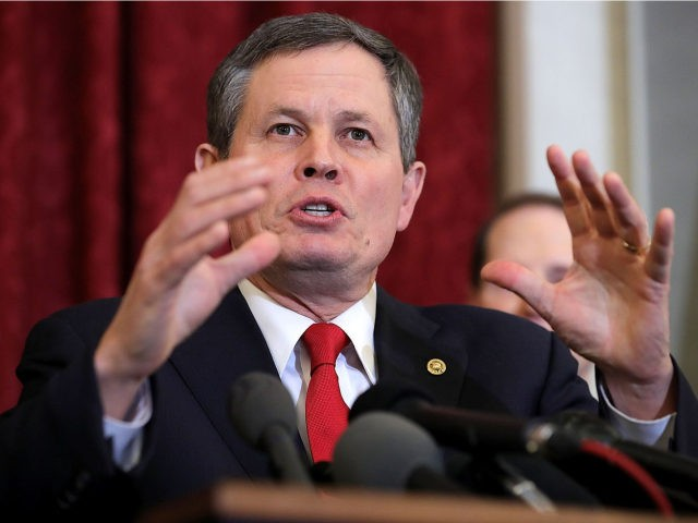 Sen. Steve Daines (R-MT) speaks during a news conference about proposed reforms to the Foreign Intelligence Surveillance Act in the Russell Senate Office Building on Capitol Hill January 16, 2018 in Washington, DC. Daines is part of a bipartisan group of senators that supports legislation they say would protect Americans …
