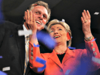 Then-Sen. Hillary Rodham Clinton and then-campaign chairman Terry McAuliffe celebrate at Clinton's primary election night celebration on May 13, 2008 in Charleston, W.Va. (Robyn Beck/AFP/Getty Images)
