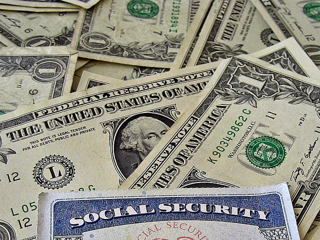 Social Security Card A social security card on a bed of money