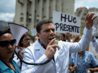 Health workers shout slogans demanding fair and higher wages during a protest for the lack of medicines, medical supplies and poor conditions in hospitals, in front of the headquarters of the Episcopal Conference in Caracas, on July 25, 2018. - The South American nation earns 96 percent of its revenue …