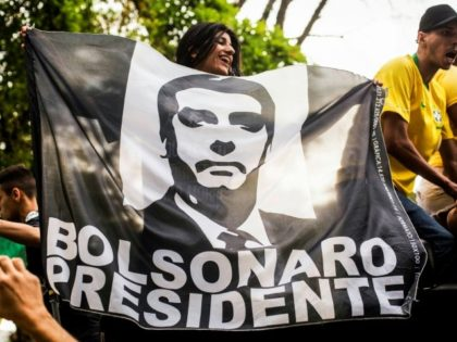 Supporters of Brazilian right-wing presidential candidate Jair Bolsonaro welcome the politician as he arrives in Rio de Janeiro after he was discharged from a Sao Paulo hospital where he was treated for a knife wound