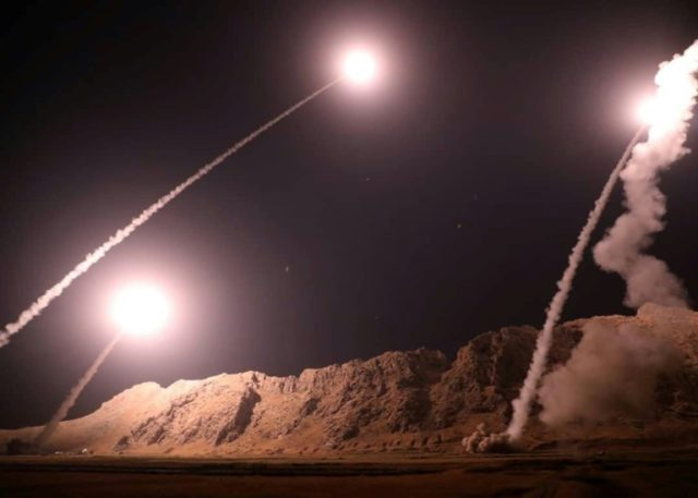 This handout photo provided by Iran's Revolutionary Guard official website via SEPAH News shows missiles being launched from an undisclosed location to target militants in eastern Syria early on October 1, 2018