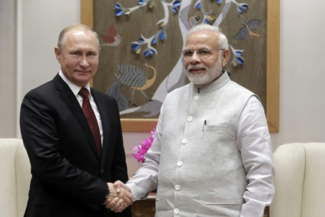Hugs as Putin clinches India defence deal