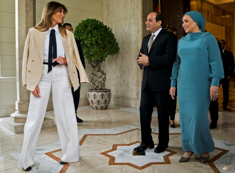 US First Lady Melania Trump (L) is welcomed by Egyptian President Abdel Fattah al-Sisi (C) and his wife Intissar Amer (R) upon arrival at the Presidential palace in the Egyptian capital Cairo
