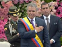 Colombia's President Ivan Duque receives the presidential sash during his inauguration on August 7, 2018 in Bogota