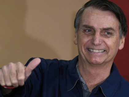 Brazil's right-wing presidential candidate Jair Bolsonaro gives a thumb up after voting in Rio de Janeiro
