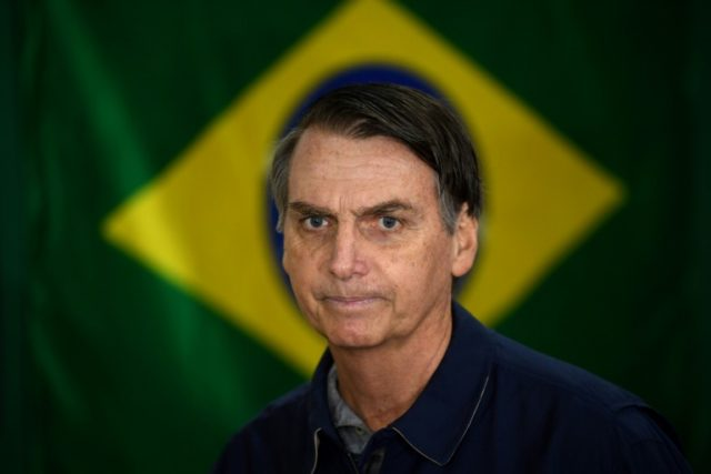 Divided Brazil barrels towards uncertain presidential run-off