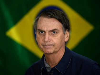 Brazil's far-right presidential candidate Jair Bolsonaro -- shown here voting in the first round -- will face leftist Fernando Haddad in an October 28 run-off