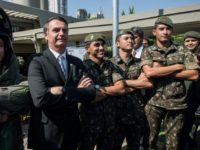 Jair Bolsonaro, a former army captain and now the front-runner in Brazil's presidential elections that have gone to a second round, poses for pictures with members of the armed forces during a military event in Sao Paulo, Brazil