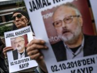 Protesters hold a portrait of missing journalist and Riyadh critic Jamal Khashoggi