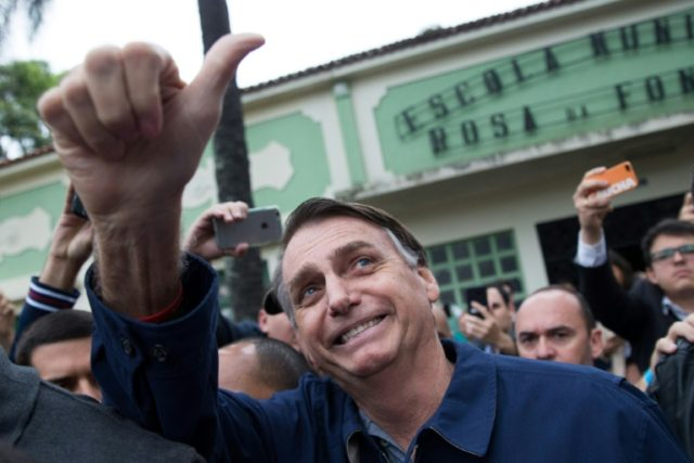 Brazil's right-wing presidential candidate Jair Bolsonaro, pictured during first round voting for the presidential election on October 7, 2018, has sent a chill through investors
