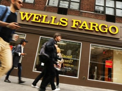 Wells Fargo saw profits surge in the third quarter but revenues were flat and loans fell