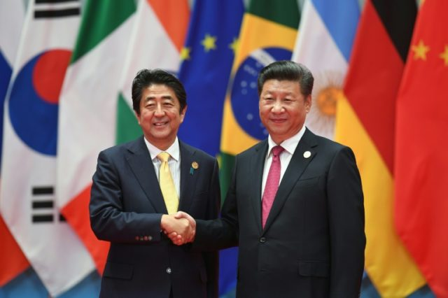 Japan PM Abe to make rare China visit this month