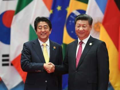 Japan's Shinzo Abe and China's Xi Jinping have met numerous times over the last few years on the sidelines of international events but no Japanese leader has made an official visit to China since 2011