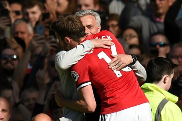 Former Manchester United midfielder Michael Carrick embraces manager Jose Mourinho as he leaves the pitch at Old Trafford