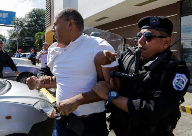 Nicaragua police arrest 20, use stun grenades to end anti-govt demo