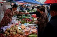 Bad weather hit farmers in China, pushing up the price of their produce and contributing to rising inflation