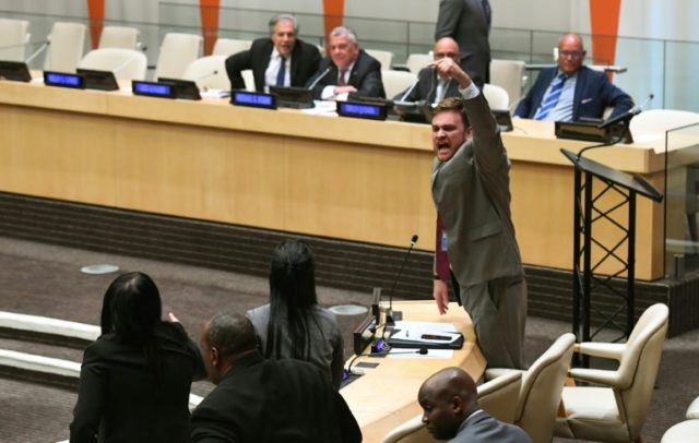 "Cuban diplomats, pictured protesting at the United Nations, demanded an end to the ""blockade of Cuba."""