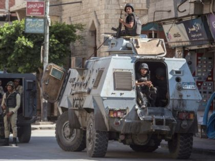 A picture taken on July 26, 2018 shows Egyptian police officers in the North Sinai provincial capital of El-Arish