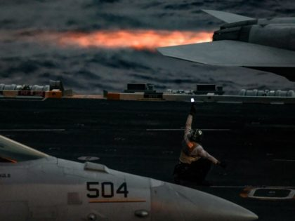 US warplanes prepare to take off from the US navy aircraft carrier Harry S. Truman for air strikes against Islamic State group targets in Syria and Iraq in May 2018