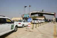 Vehicles arrive at the border crossing between Jordan and Syria on the day of its reopening on October 15, 2018