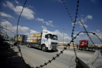 A truck carrying goods to Palestinians arrives at Kerem Shalom crossing in the southern Gaza Strip on August 15, 2018