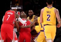 Houston Rockets Chris Paul, left, and Rajon Rondo of the Los Angeles Lakers trade blows during a 124-115 Rockets win to spoil LeBron James home debut