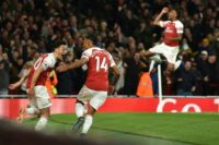 Pierre-Emerick Aubameyang celebrated with Mesut Ozil as Arsenal saw off Leicester