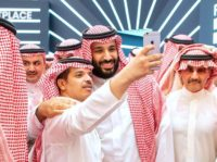Saudi Crown Prince Mohammed bin Salman, seen here posing for a selfie during a brief appearance at the opening of a flagship investment forum in Riyadh, is scheduled on day two to give his first speech since the murder of critic Jamal Khashoggi