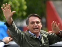 Jair Bolsonaro, far-right lawmaker and presidential candidate for the Social Liberal Party (PSL), gives thumbs up to supporters, during the second round of the presidential elections, in Rio de Janeiro, Brazil