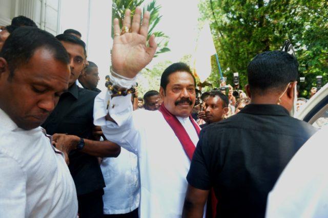 Sri Lankan rivals tempt defectors to swing crisis