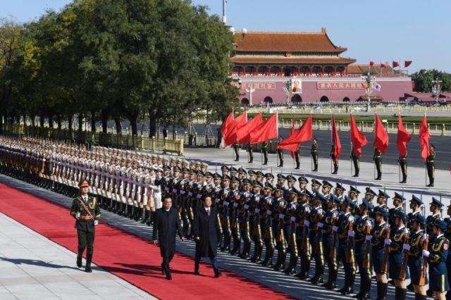 Japan, China strike deals during Abe visit as ties improve